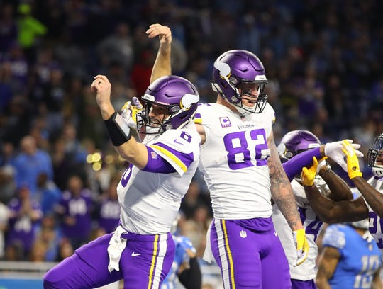 Vikings quarterback Kirk Cousins and tight end Kyle Rudolph celebrate a touchdown during the first half on Sunday, Dec. 23, 2018, at Ford Field.