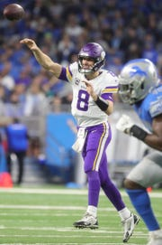 Minnesota Vikings quarterback Kirk Cousins passes during second half action against the Detroit Lions during the second half at Ford Field in Detroit on Sunday, December 23, 2018.