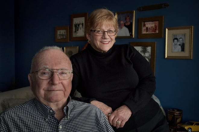 Barb and Ken Johnson pose for a photo in their Chesterfield Township home on Tuesday, December 18, 2018.