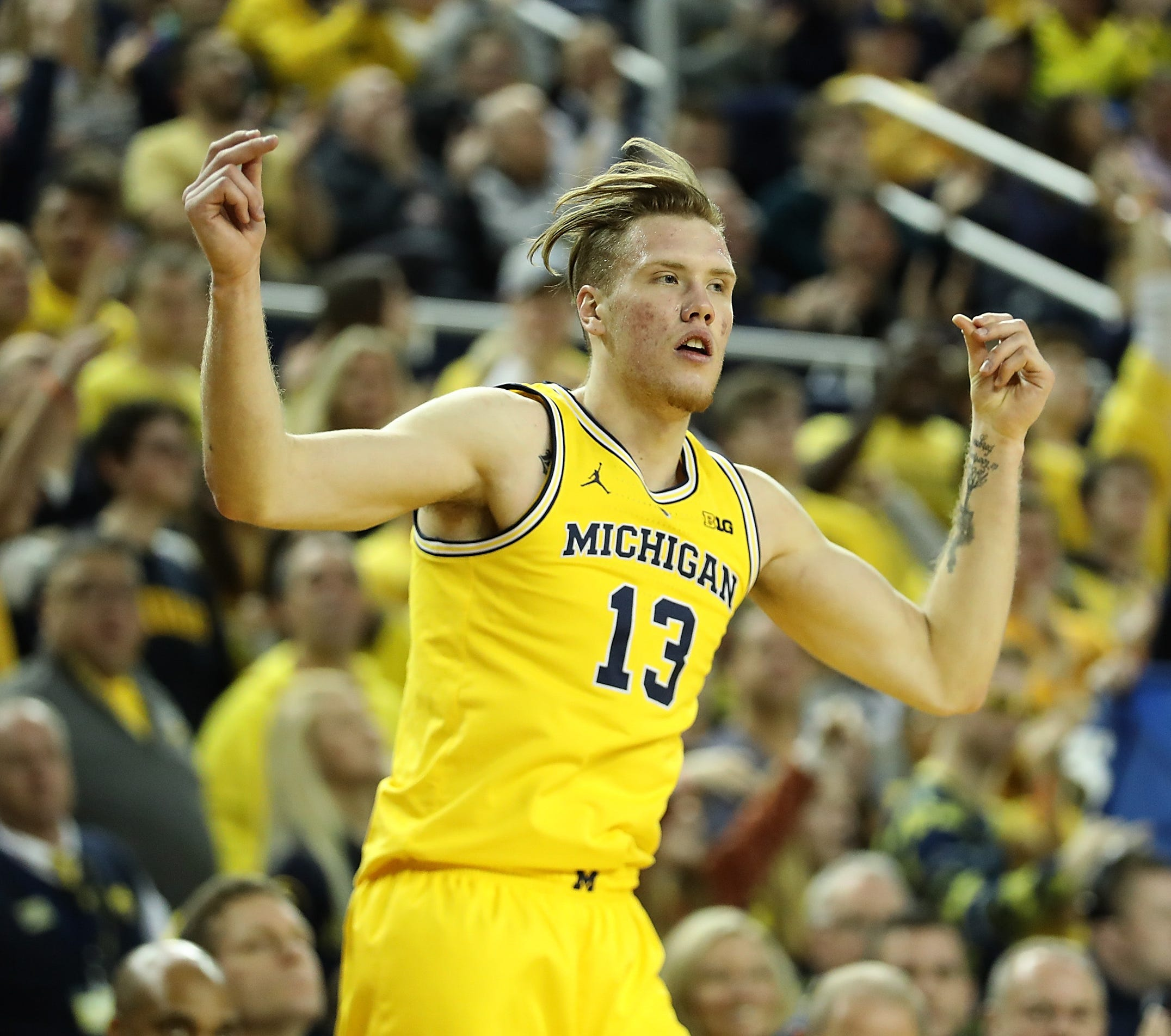 Michigan forward Ignas Brazdeikis celebrates a 3-point shot during the second half of U-M's 71-50 win on Saturday, Dec. 22, 2018, at Crisler Center.