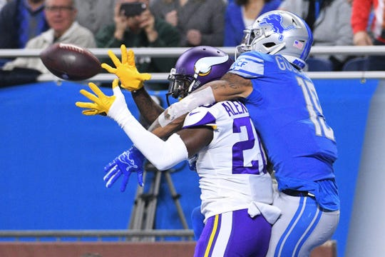 Lions wide receiver Kenny Golladay is unable to complete a pass as Vikings cornerback Mackensie Alexander break up the play during the first half on Sunday, Dec. 23, 2018, at Ford Field.