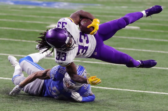 Detroit Lions cornerback Mike Ford tackles Minnesota Vikings running back Dalvin Cook during the first half at Ford Field in Detroit on Sunday, December 23, 2018.