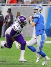 Detroit Lions quarterback Matt Cassel is rushed by Minnesota Vikings defensive end Jaleel Johnson during the second half at Ford Field in Detroit on Sunday, December 23, 2018.