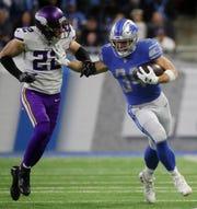 Zach Zenner runs by Vikings safety Harrison Smith on Dec. 23, 2018.
