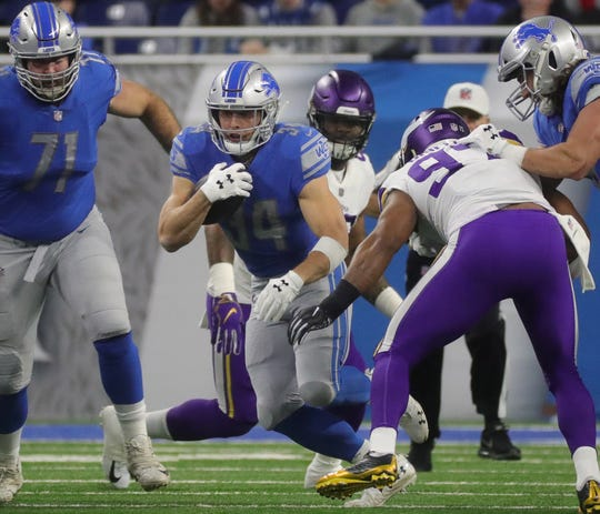 Detroit Lions running back Zach Zenner runs against the Minnesota Vikings during the first half at Ford Field in Detroit on Sunday, December 23, 2018.