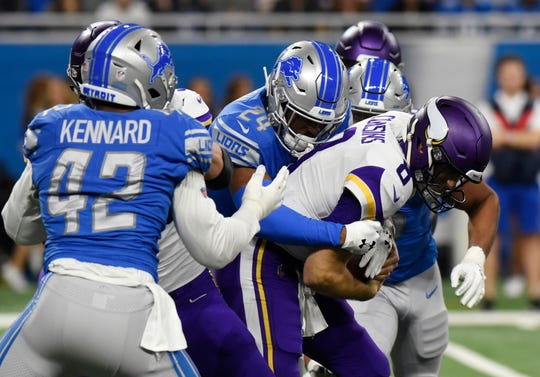 Vikings quarterback Kirk Cousins is sacked by Lions cornerback Nevin Lawson (24) during the first half on Sunday, Dec. 23, 2018, at Ford Field.