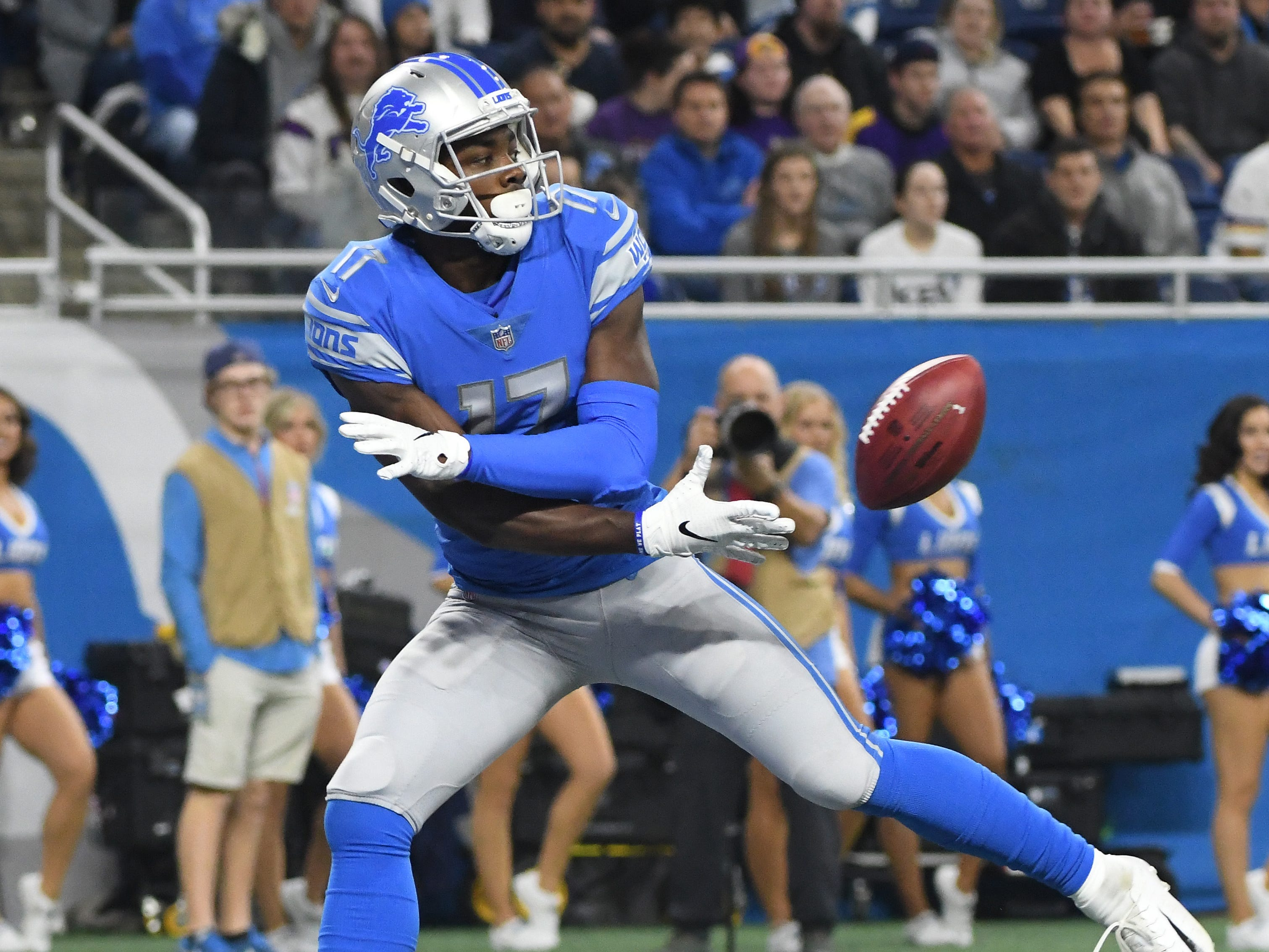 Lions wide receiver Andy Jones tosses back a Vikings punt to a teammate who downs the ball at the two yard line, giving Minnesota rough field position to start their offensive drive in the first quarter.