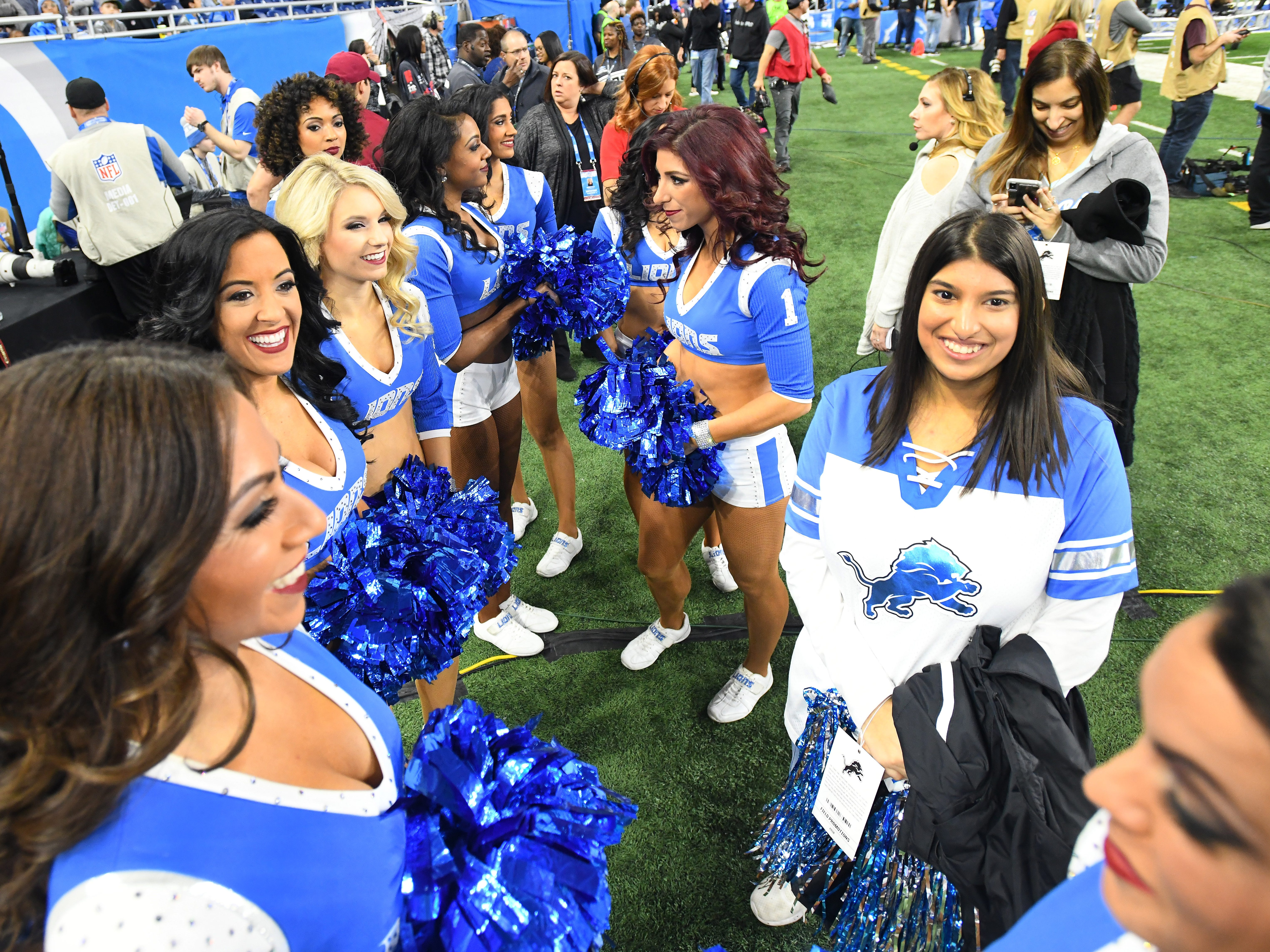 Grand Blanc High School student Hiba Syed meets with the Detroit Lions Cheerleaders on the field before Detroit takes on the Minnesota Vikings at Ford Field.
