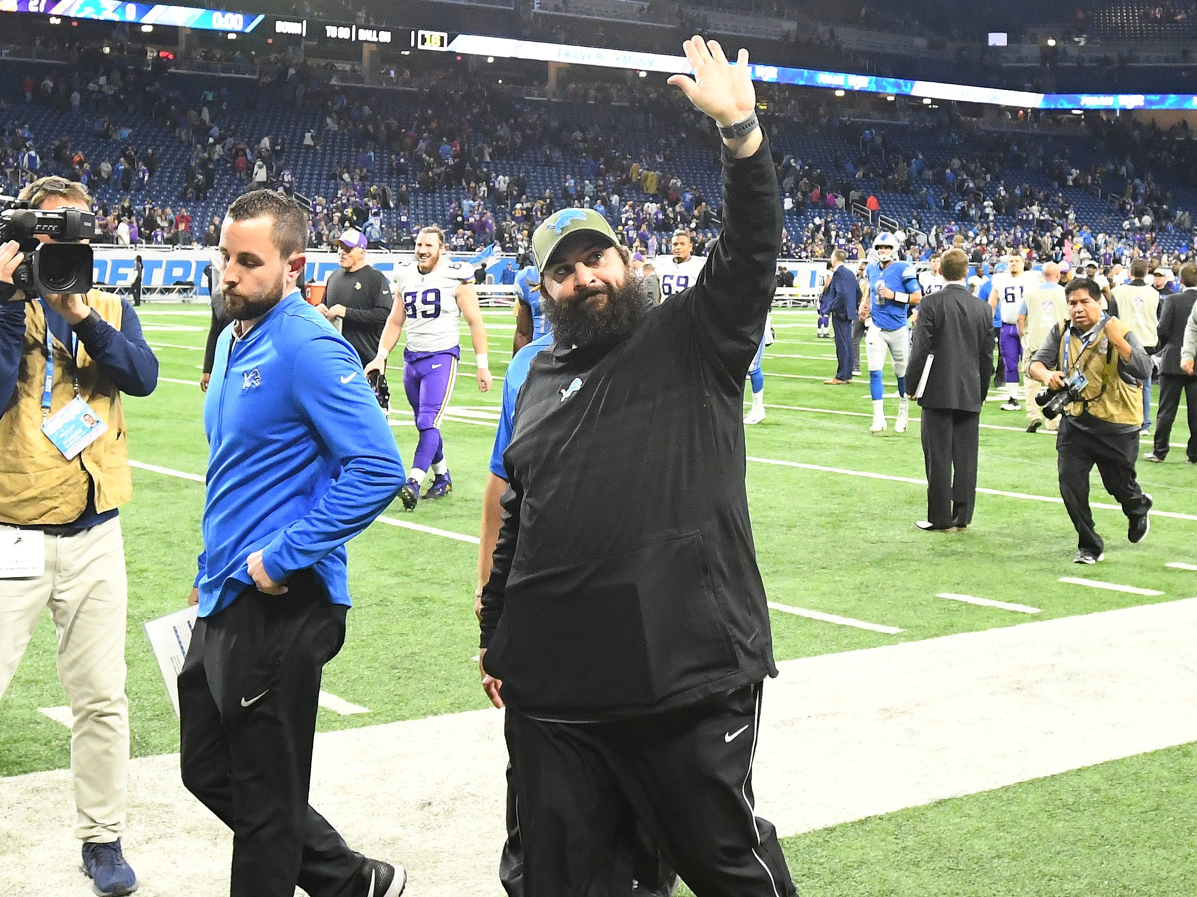 Lions head coach Matt Patricia walks off the field, waving up to the stands, as he does after every game, after losing to the Vikings 27-9.