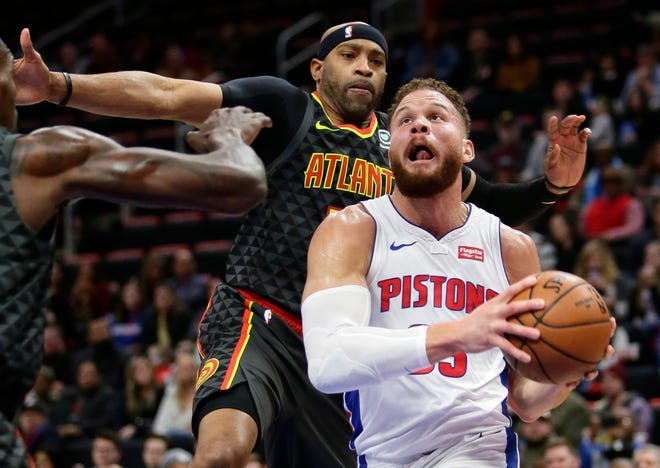Detroit Pistons forward Blake Griffin (23) goes to the basket past Atlanta Hawks forward Vince Carter during the first half on Sunday.