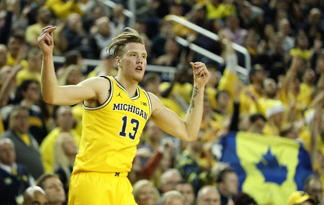 Ignas Brazdeikis of the Michigan Wolverines celebrates a 3-pointer during the second half. Brazdeikis finished with 19 points in No. 4 Michigan's 71-50 win over Air Force on Saturday at Crisler Center.
