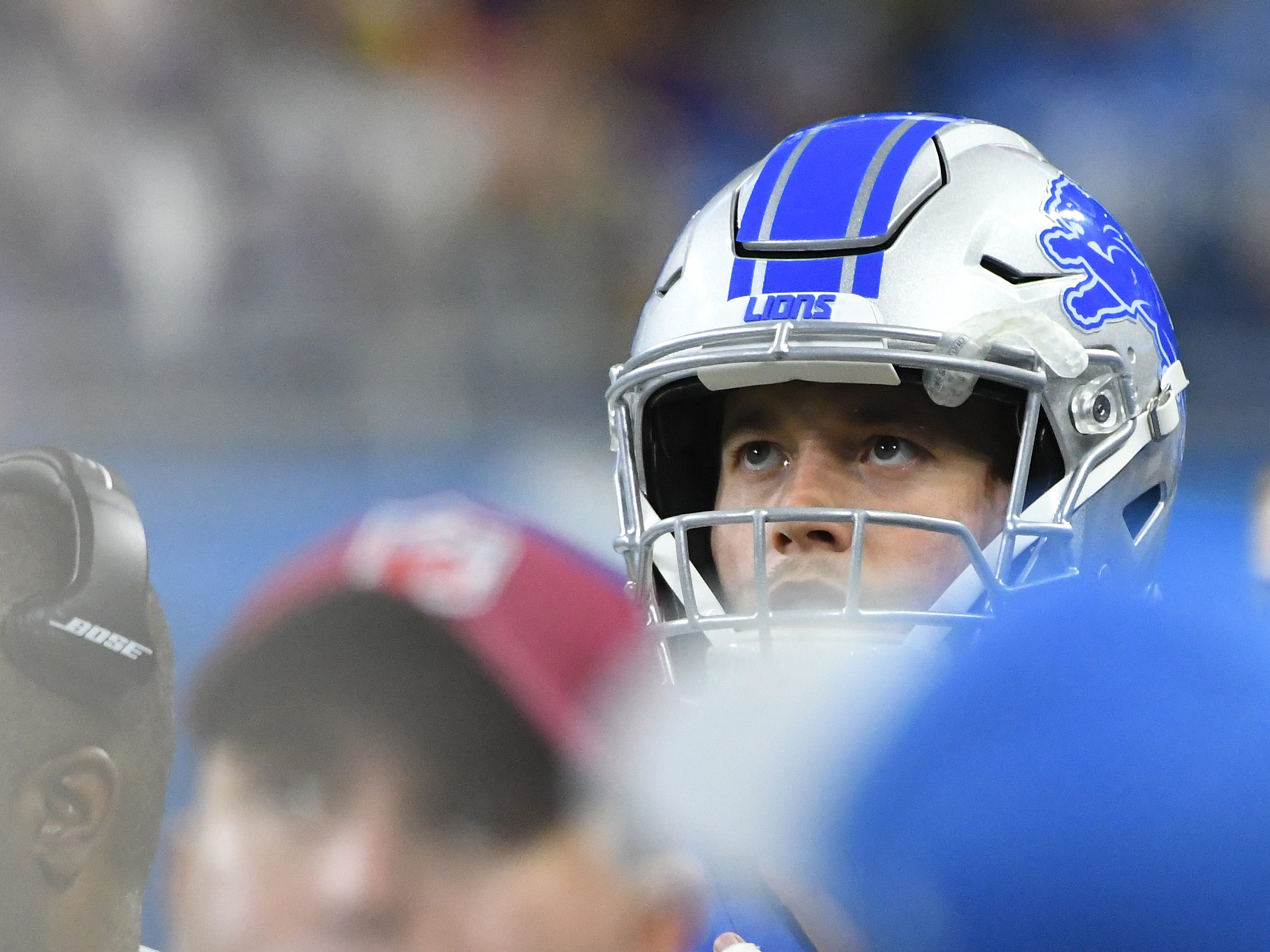 Lions quarterback Matt Stafford watches the video board with a taped up pinky finger as backup quarterback Matt Cassel finishes up the game late in the fourth quarter.
