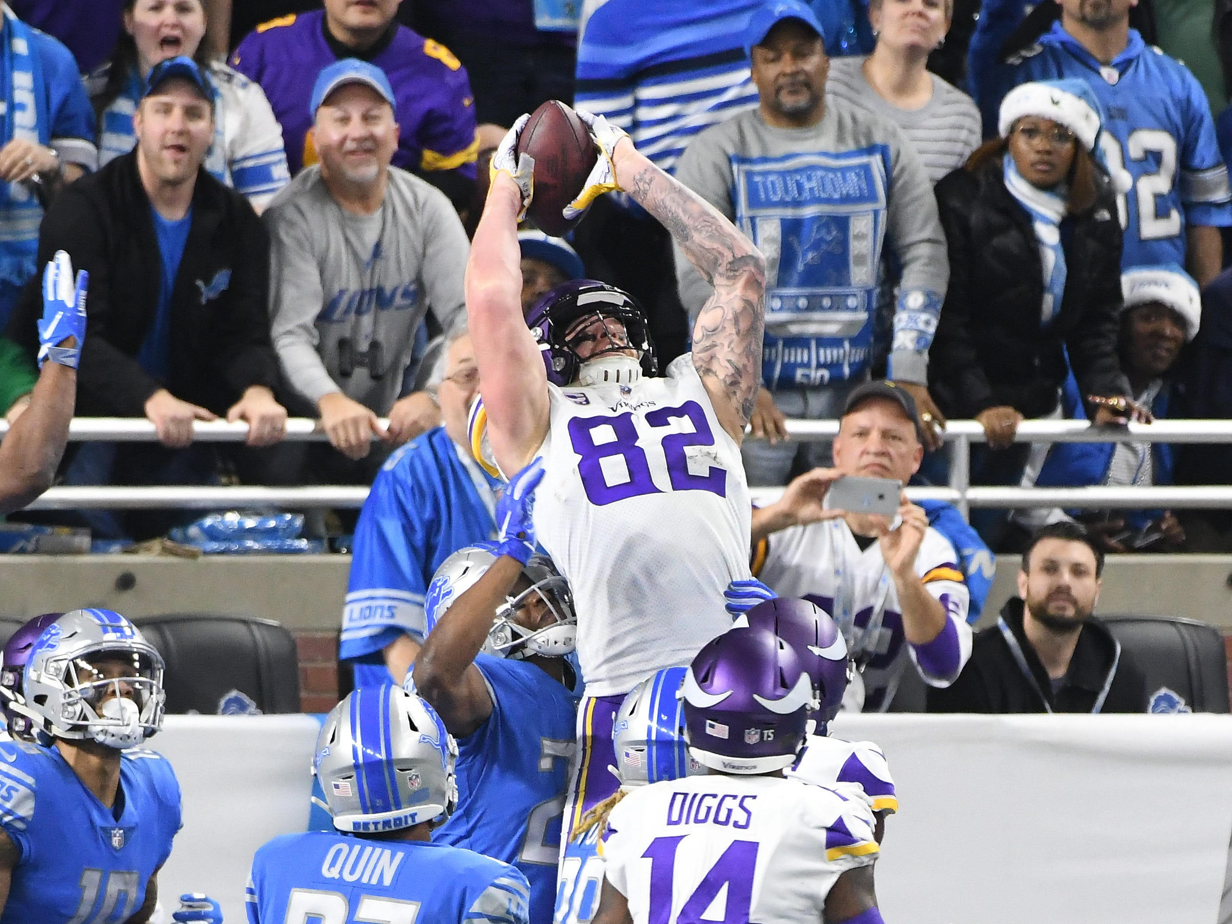 Viking's Kyle Rudolph pulls off 'Hail Mary' catch in the end zone as the clock runs out in the first half with Vikings leading 14-9.   NFL Detroit Lions vs. Minnesota Vikings at Ford Field in Detroit, Michigan on Dec. 23, 2018.