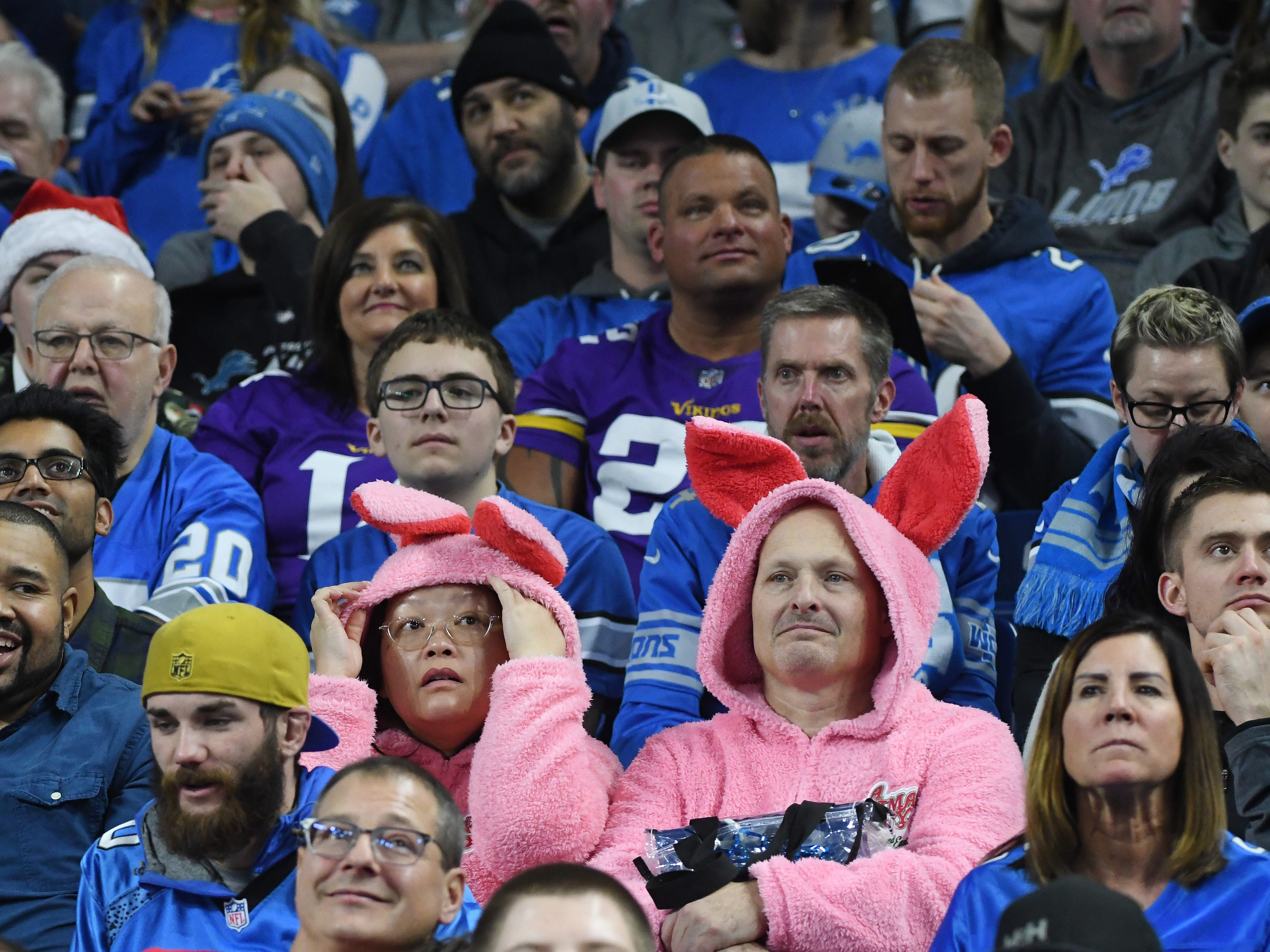 Fans in Ford Field, wearing bunny suits similar to the one in the movie Christmas Story, watch Detroit drop another game, this time to the Vikings, 27-9.