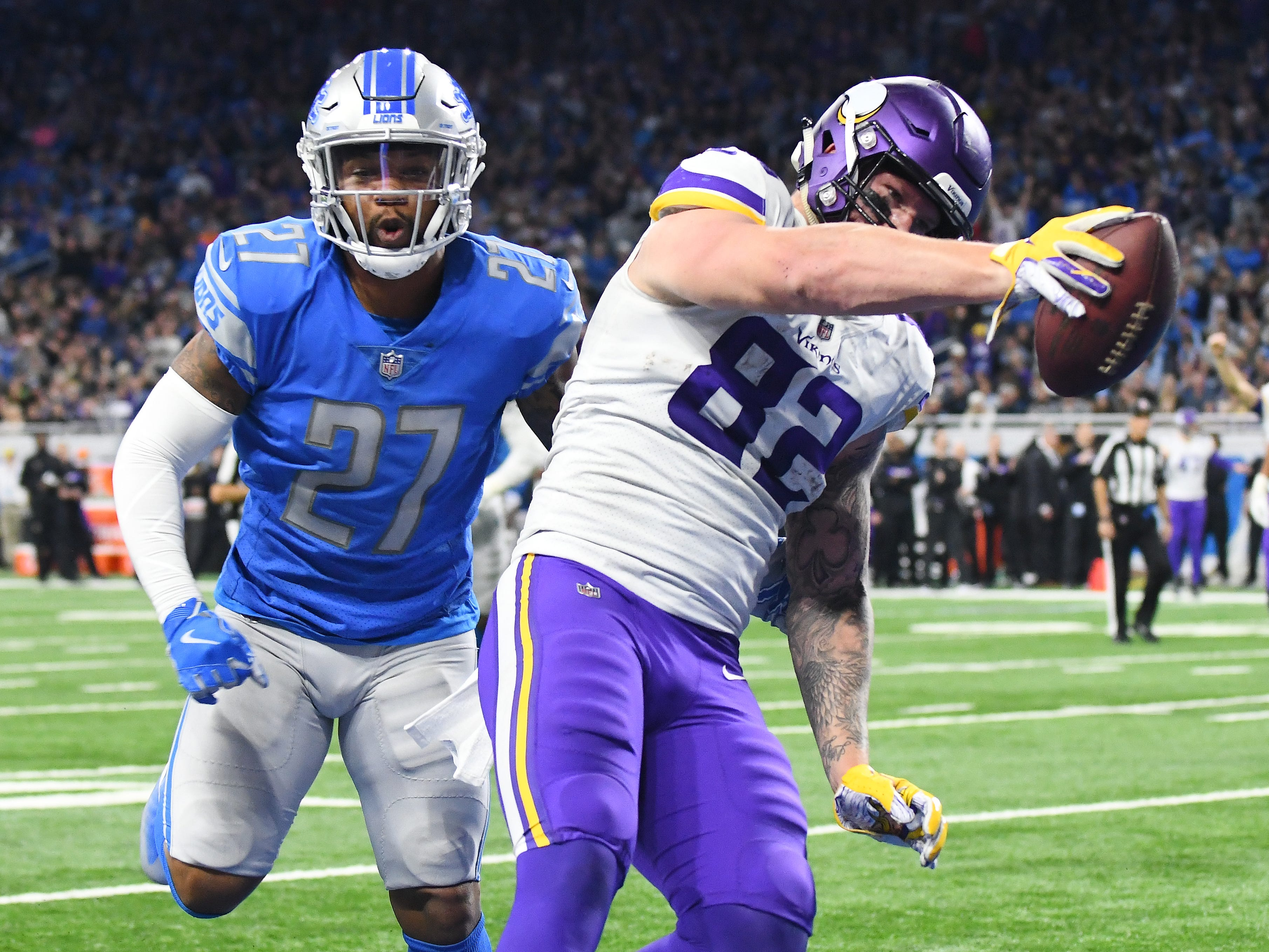 Lions' Glover Quin can't stop Vikings tight end Kyle Rudolph from going into the endzone for a touchdown in the fourth quarter.