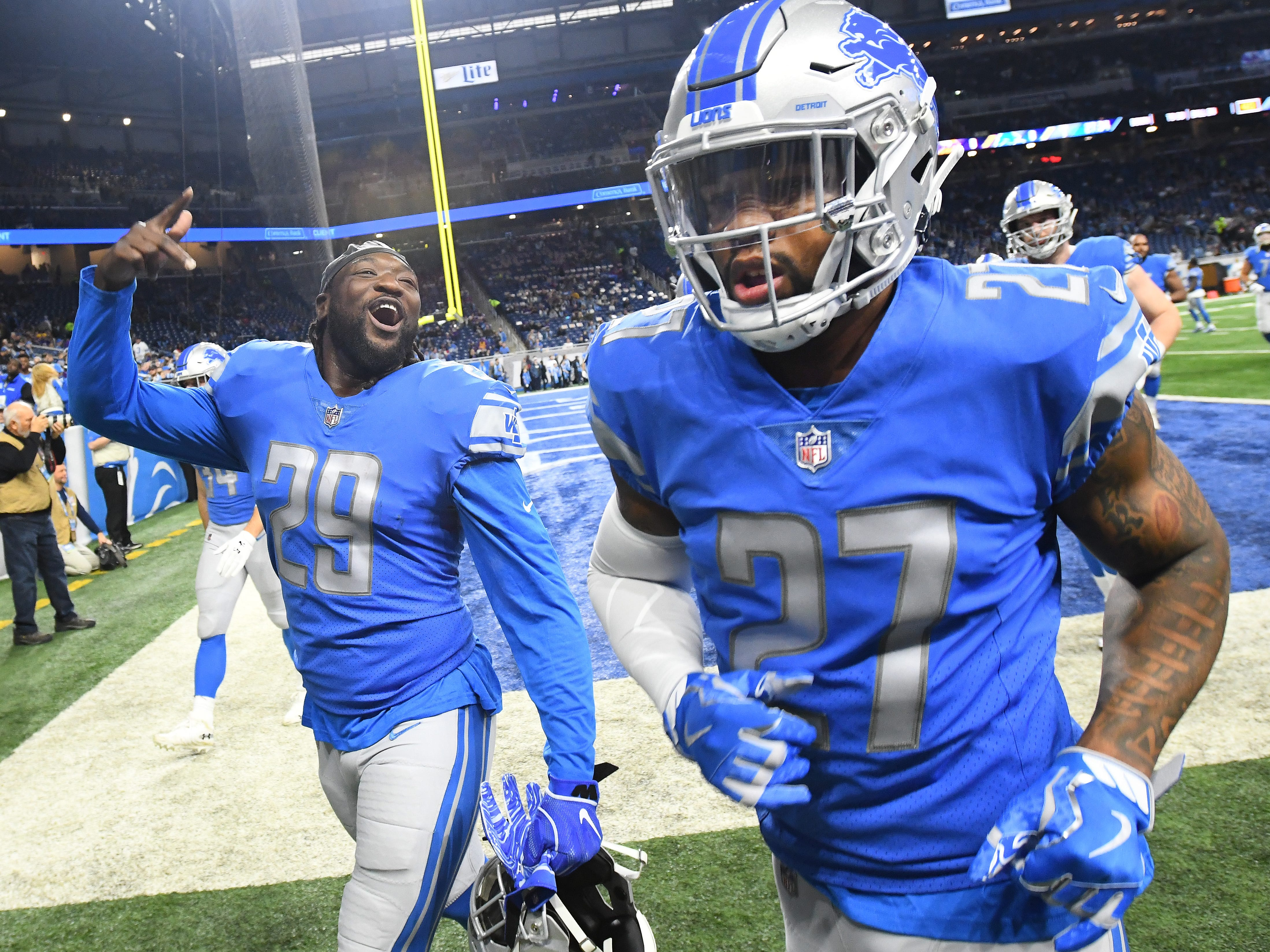 Lions running back LeGarrette Blount and safety Glover Quin leave the field after warmups.