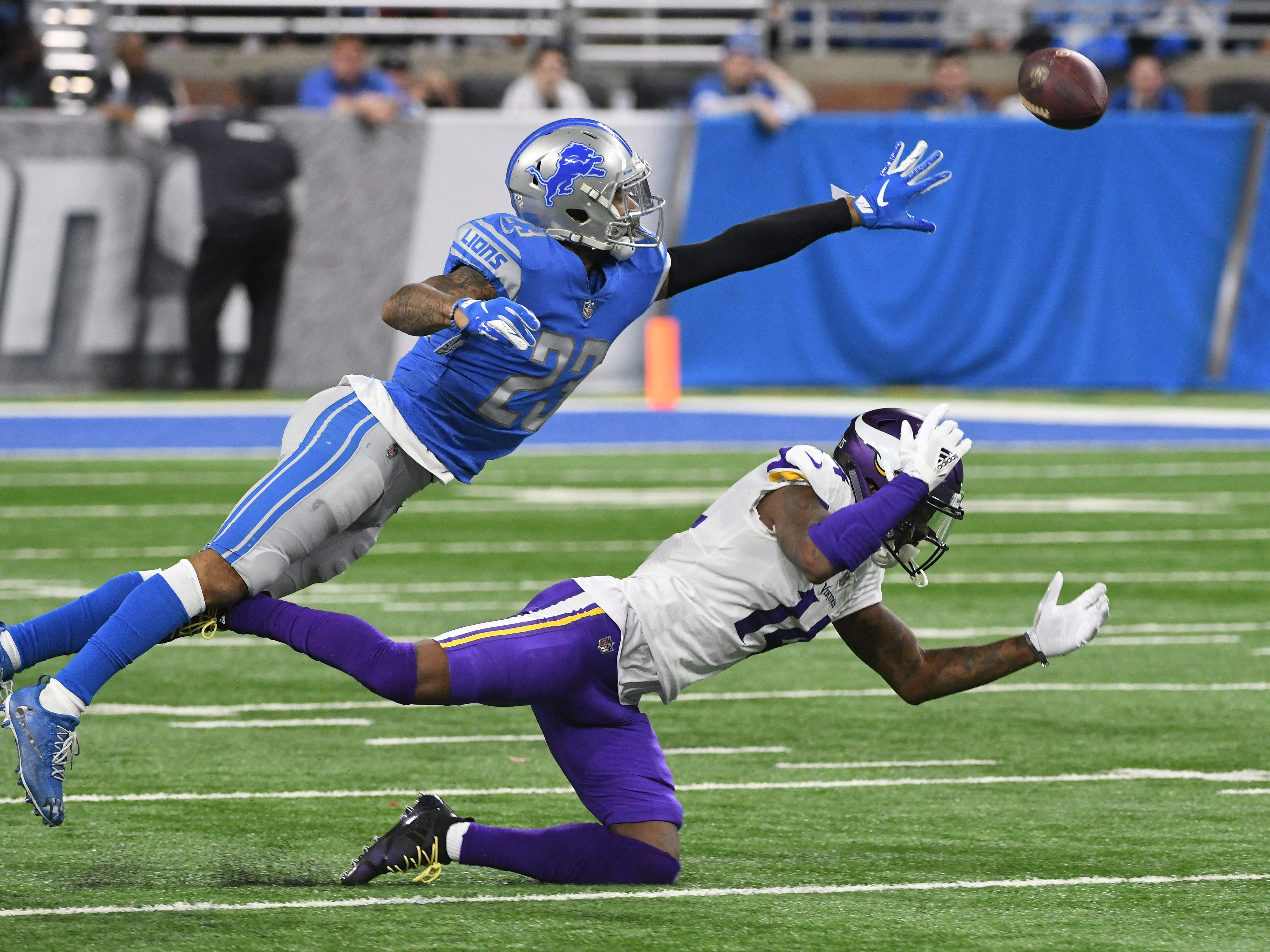 Lions' Darius Slay breaks up a reception intended for Vikings' Stefon Diggs in the fourth quarter.