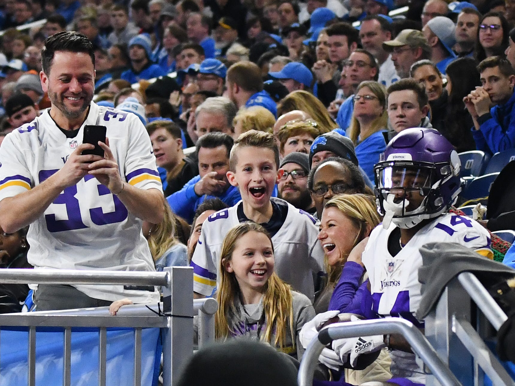 Vikings' Stefon Diggs goes into the stands and sits with Vikings fans after scoring a touchdown in the second quarter.