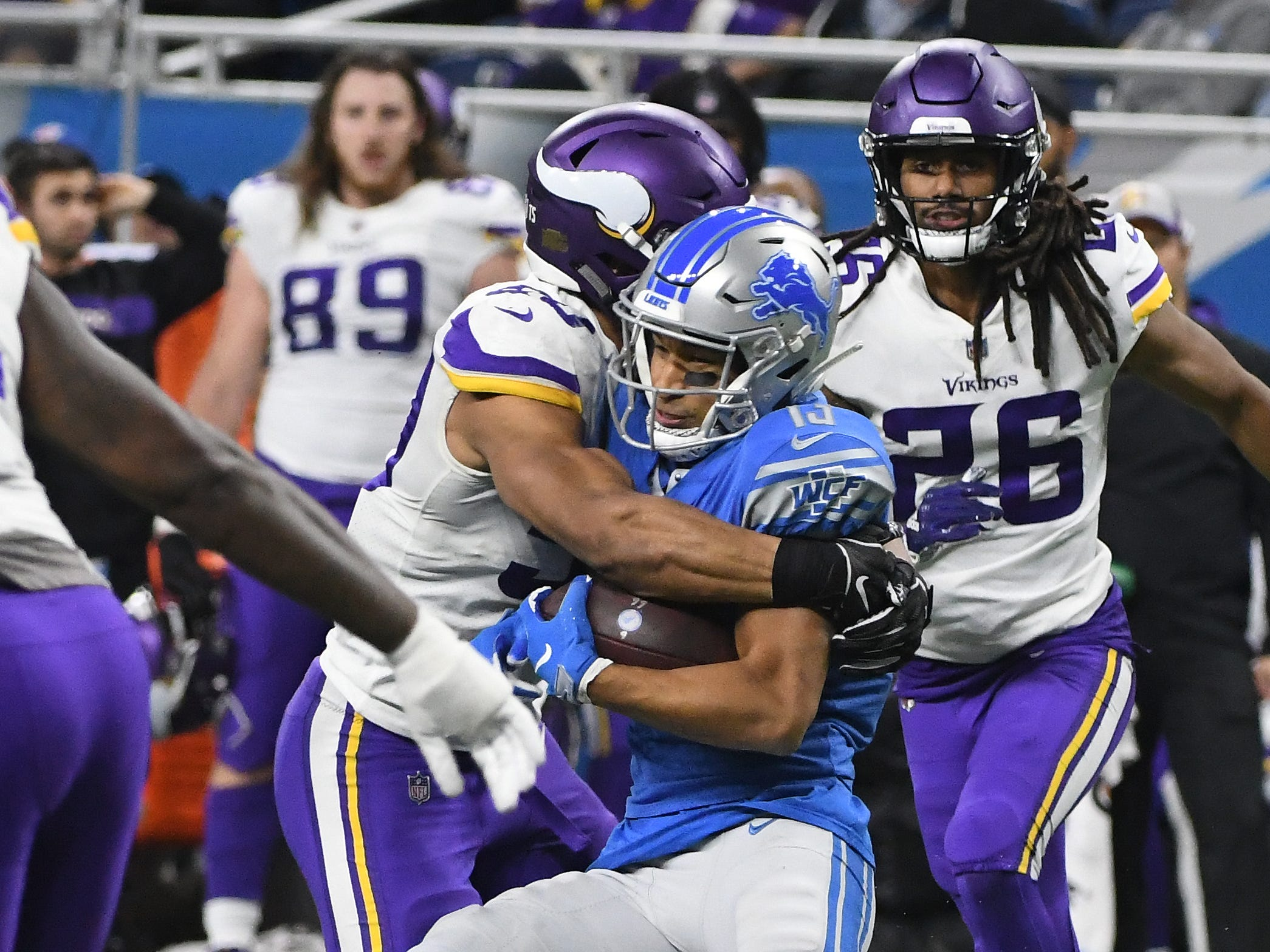Vikings' Eric Wilson brings down Lions' T.J. Jones after a reception late in the fourth quarter.