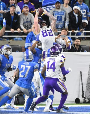 The Vikings' Kyle Rudolph gathers a Hail Mary catch in the end zone as the clock runs out in the first half.