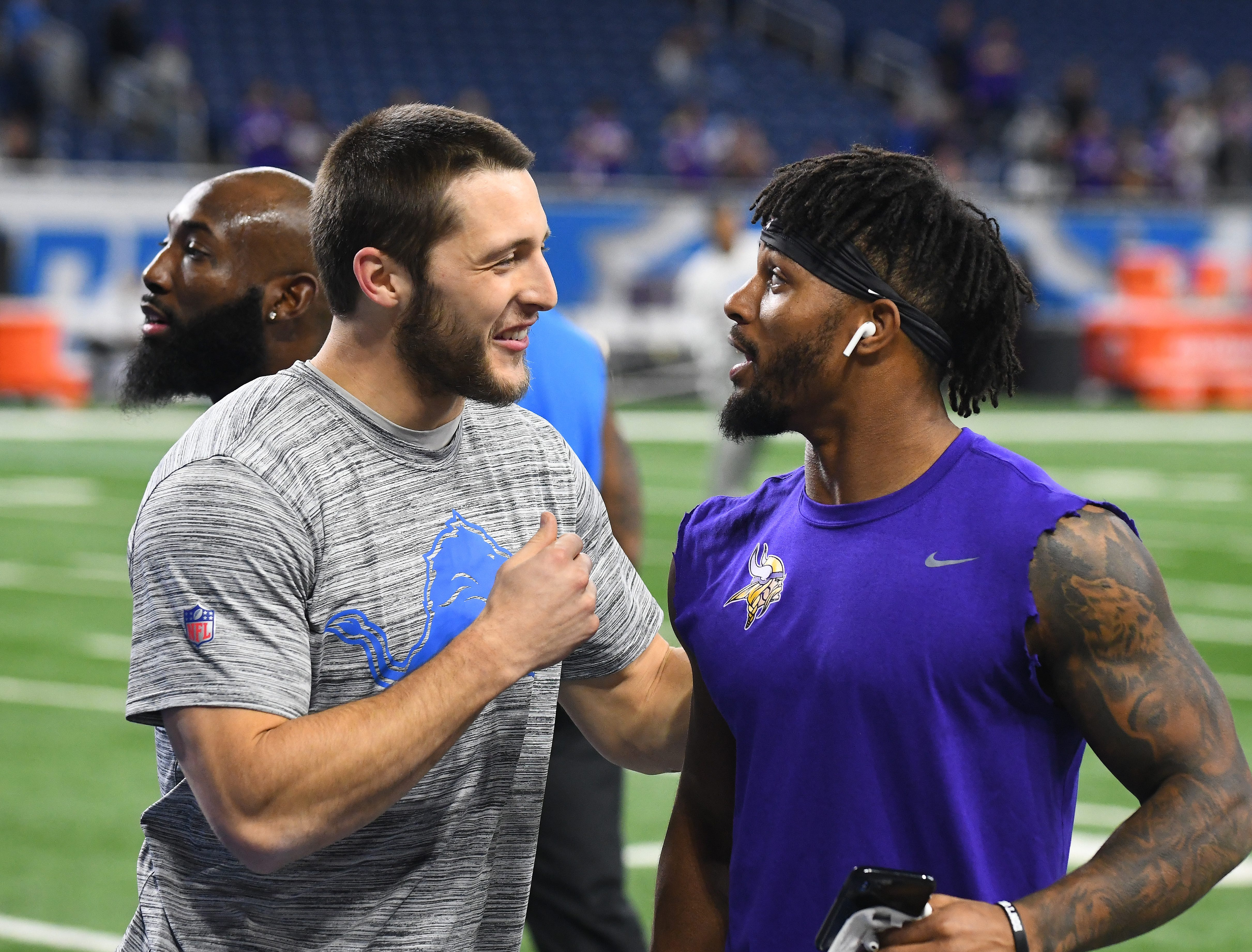 Lions running back Zach Zenner greets former Lions running back, now with the Vikings, Ameer Abdullah on the field before Detroit takes on Minnesota at Ford Field in Detroit, Michigan on December 23, 2018.