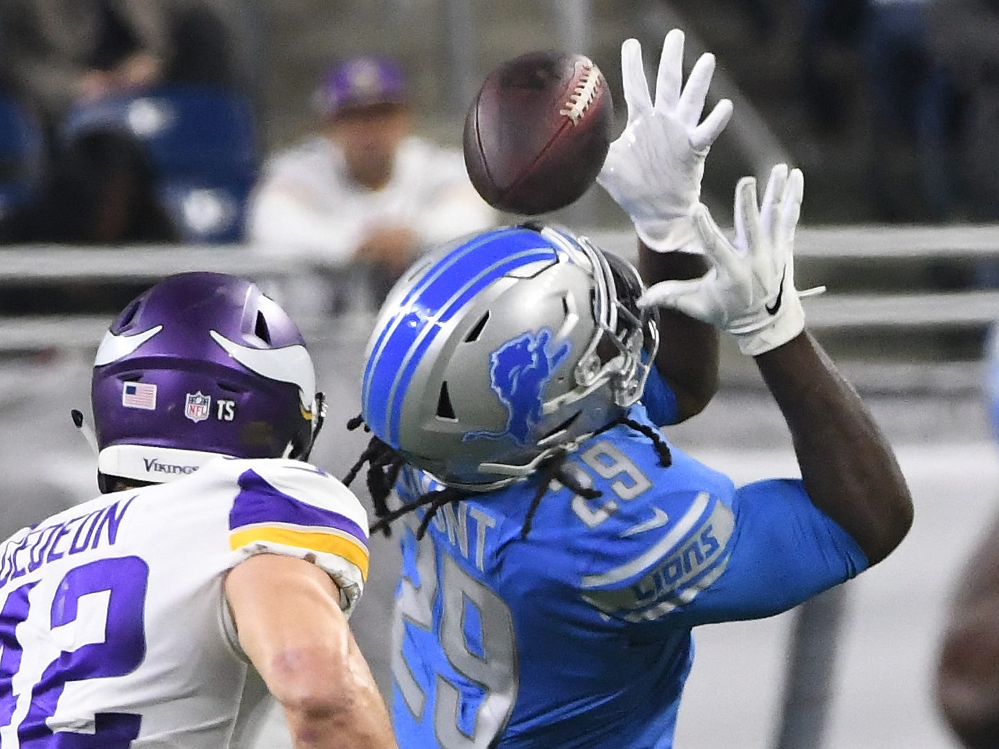 A pass to Lions running back LeGarrette Blount bounces off is helmet and goes incomplete with Vikings' Ben Gedeon defending in the first quarter.