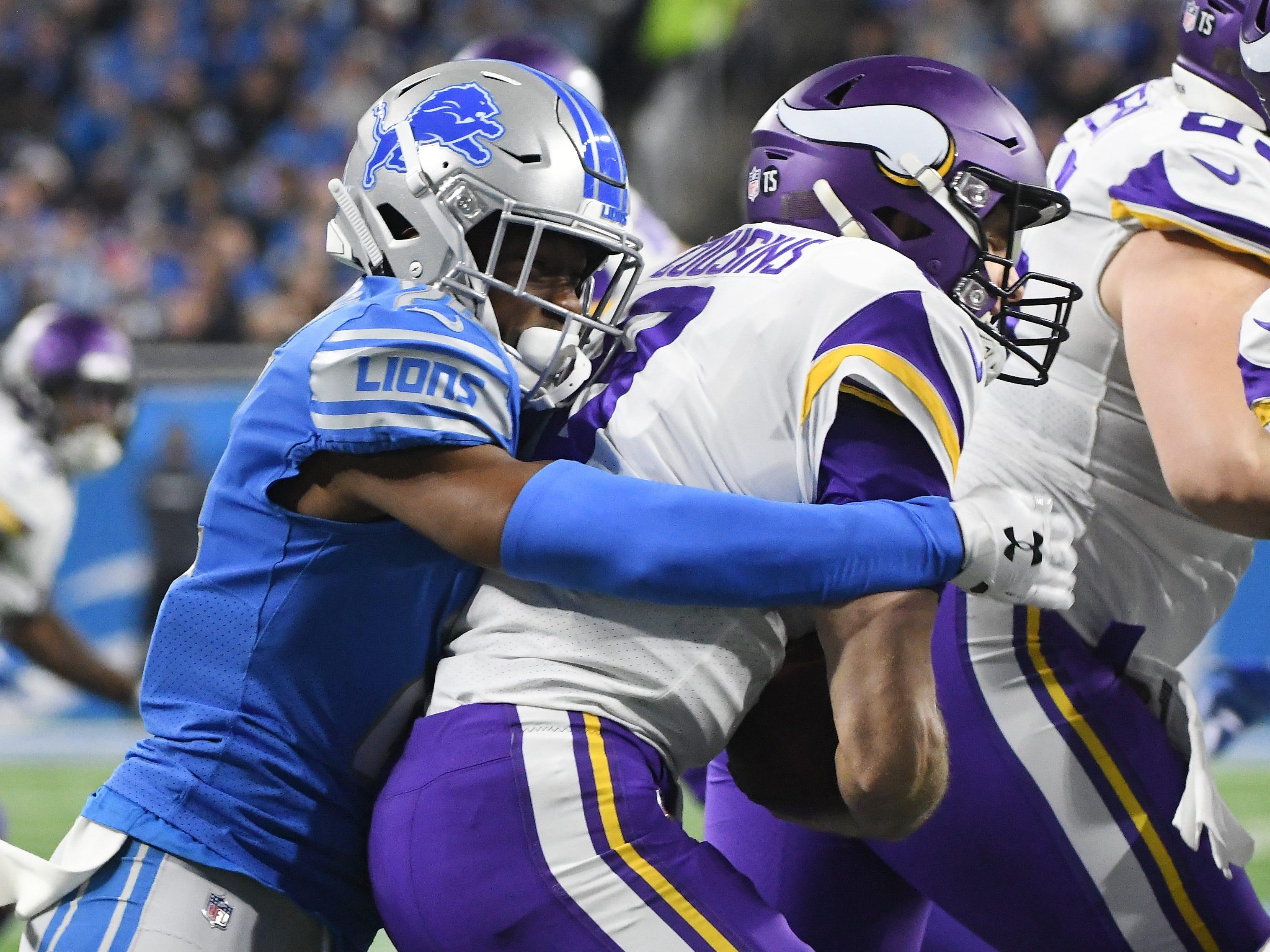 Lions' Nevin Lawson sacks Vikings quarterback Kirk Cousins in the first quarter.