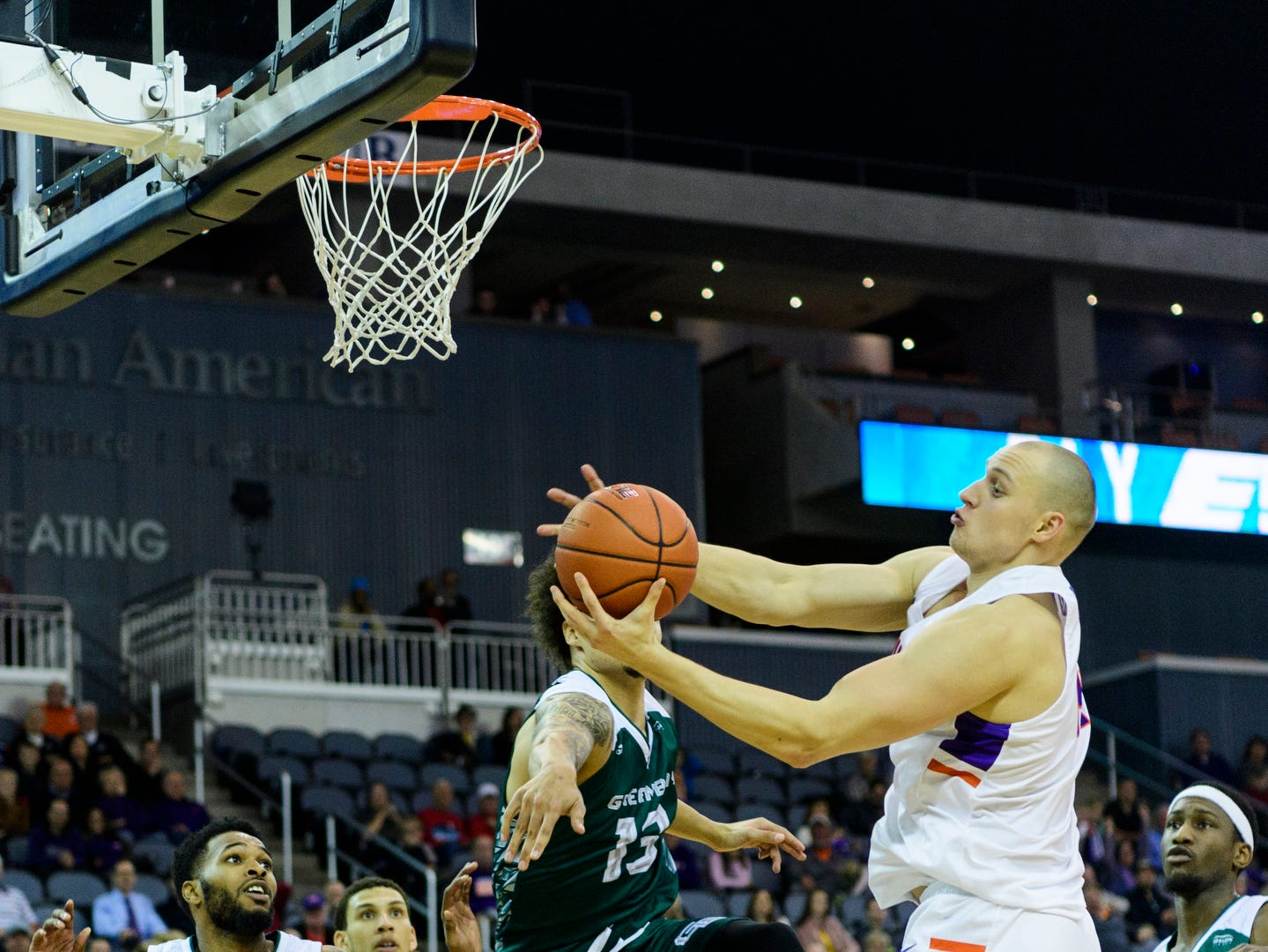 University of Evansville's Dainius Charkevicius (14) recovers the ball after Green Bay's Trevian Bell (13) swatted it away from the net during the second half at Ford Center in Evansville, Ind., Saturday, Dec. 22, 2018. The Purple Aces defeated the Phoenix 80-75 in their last non-conference game of the season.