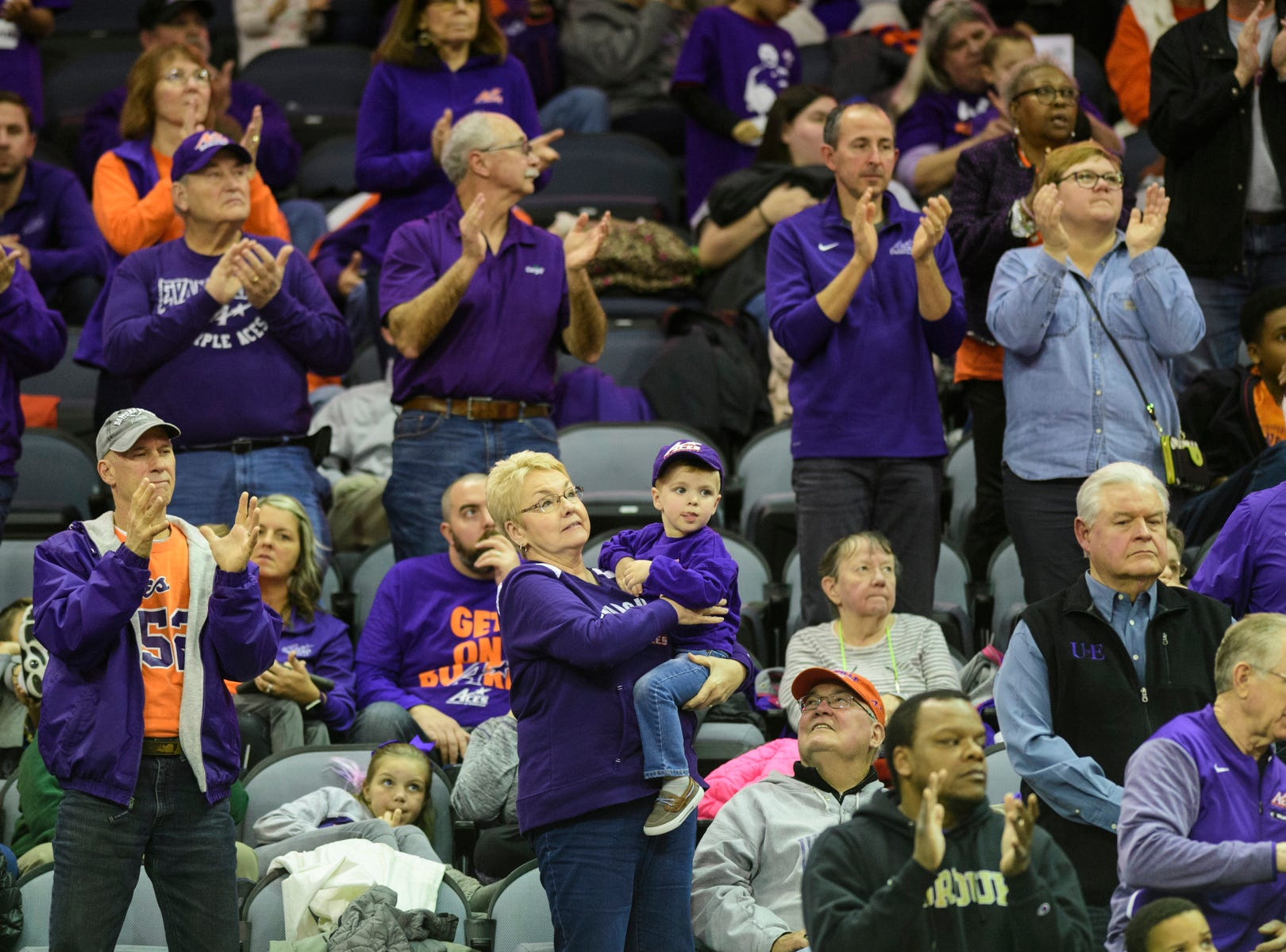 University of Evansville Purple Aces fans cheer for their team during the second half against the University of Wisconsin-Green Bay Phoenix at Ford Center in Evansville, Ind., Saturday, Dec. 22, 2018. The Purple Aces defeated the Phoenix 80-75 in their last non-conference game of the season.