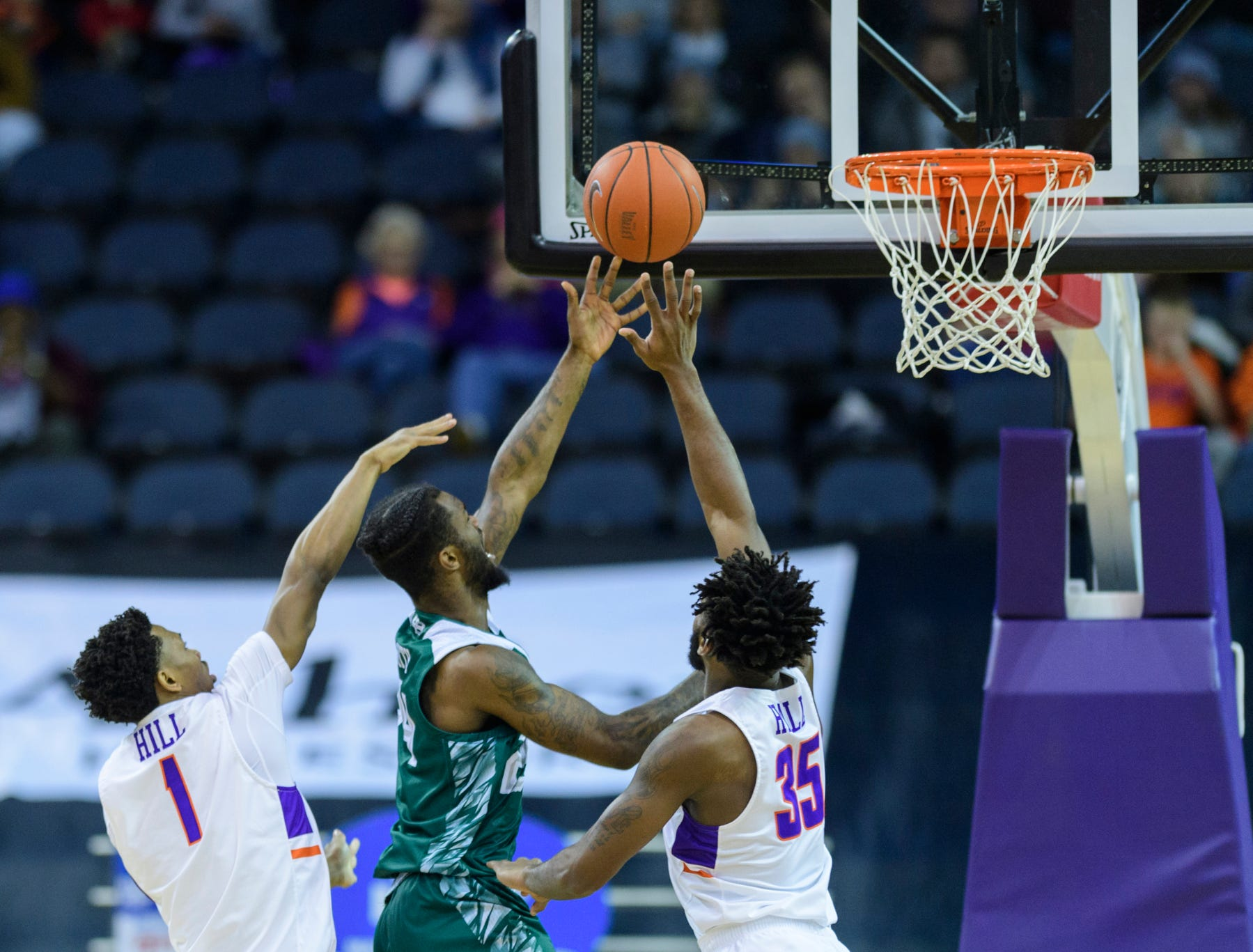 University of Evansville's Marty Hill (1) and University of Evansville's John Hall (35) block Green Bay's Jevon Smith (24) from the net during the first half at the Ford Center in Evansville, Ind., Saturday, Dec. 22, 2018. The Purple Aces defeated the Phoenix 80-75 in their last non-conference game of the season.