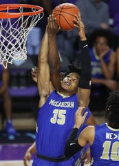 McEachern High School's Isaac Okoro rebounds against Imhotep Charter on Saturday in the championship game of the 46th Annual Culligan City of Palms Classic basketball tournament at Suncoast Credit Union Arena at Florida Southwestern State College in Fort Myers. McEachern beat Imhotep 68-47.