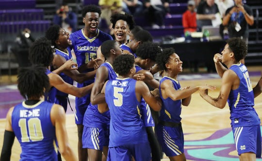 McEachern High School players celebrate defeating Imhotep Charter on Saturday in the championship game of the 46th Annual Culligan City of Palms Classic basketball tournament at Suncoast Credit Union Arena at Florida Southwestern State College in Fort Myers. McEachern beat Imhotep 68-47.