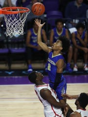 McEachern High School's Sharife Cooper shoots against Imhotep Charter on Saturday in the championship game of the 46th Annual Culligan City of Palms Classic basketball tournament at Suncoast Credit Union Arena at Florida Southwestern State College in Fort Myers. McEachern beat Imhotep 68-47.