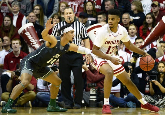 Indiana Hoosiers forward Juwan Morgan (13) backs down Jacksonville Dolphins forward Jace Hogan (14) during the game against Jacksonville at Simon Skjodt Assembly Hall in Bloomington, Ind., on Saturday, Dec. 22, 2018.