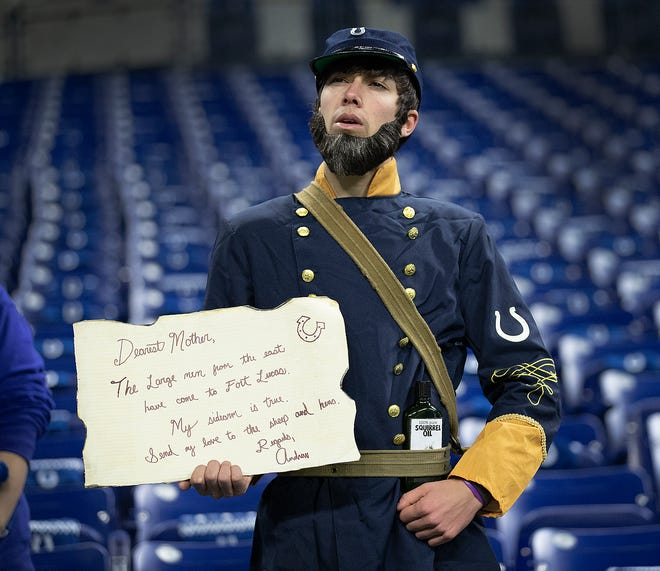 """""""Captain Andrew Luck """" or Emerson Bostic, from Westfield, before the start of their game  against the New York Giants at Lucas Oil Stadium on Sunday, Dec. 23, 2018."""