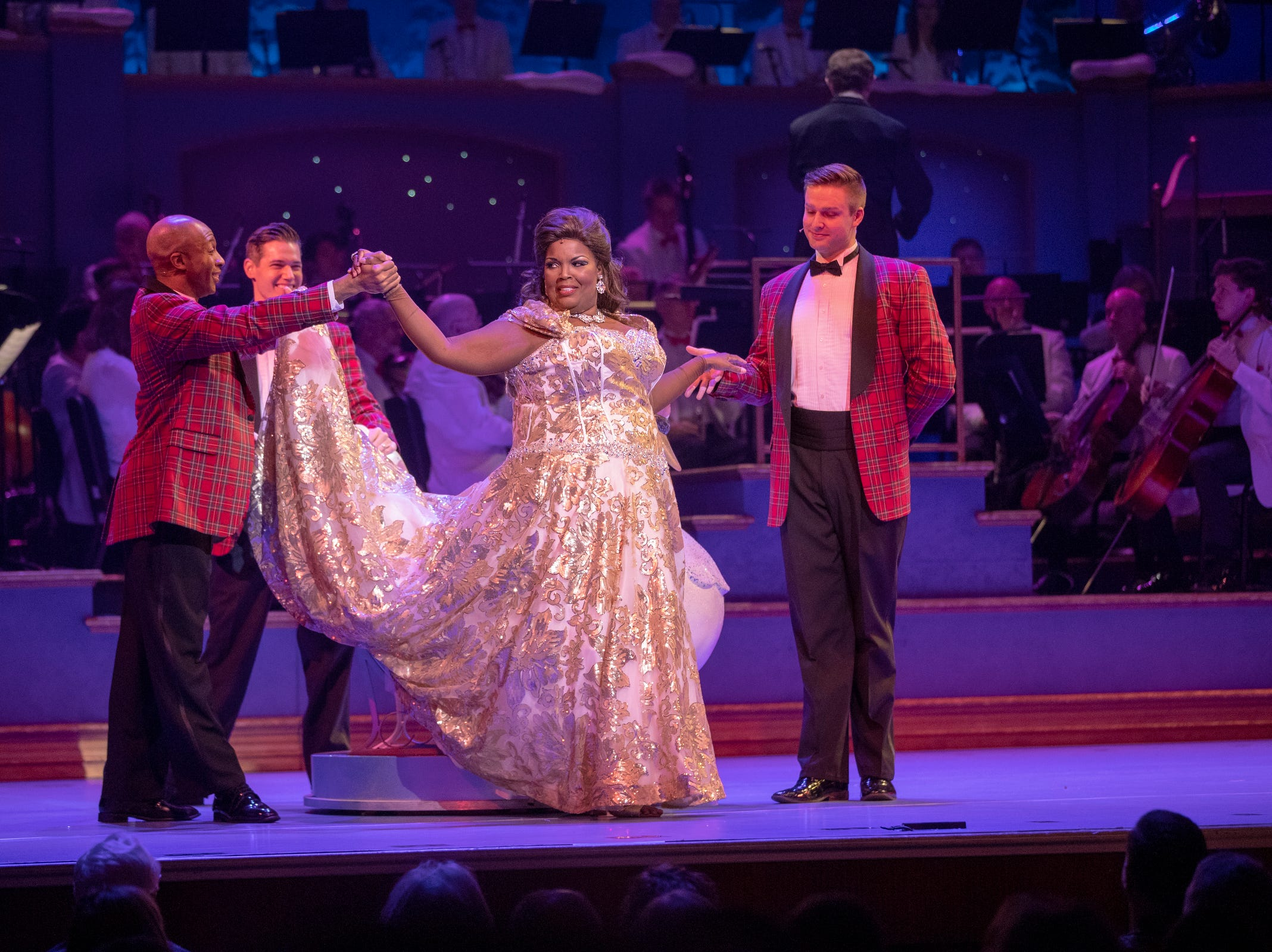 Angela Brown and the Jingle Beaux perform at Yuletide Celebration, showcasing the Indianapolis Symphony Orchestra, at Hilbert Circle Theater, Indianapolis, Sunday. Dec. 23, 2018. The extravaganza features dancing, holiday songs, and skits.