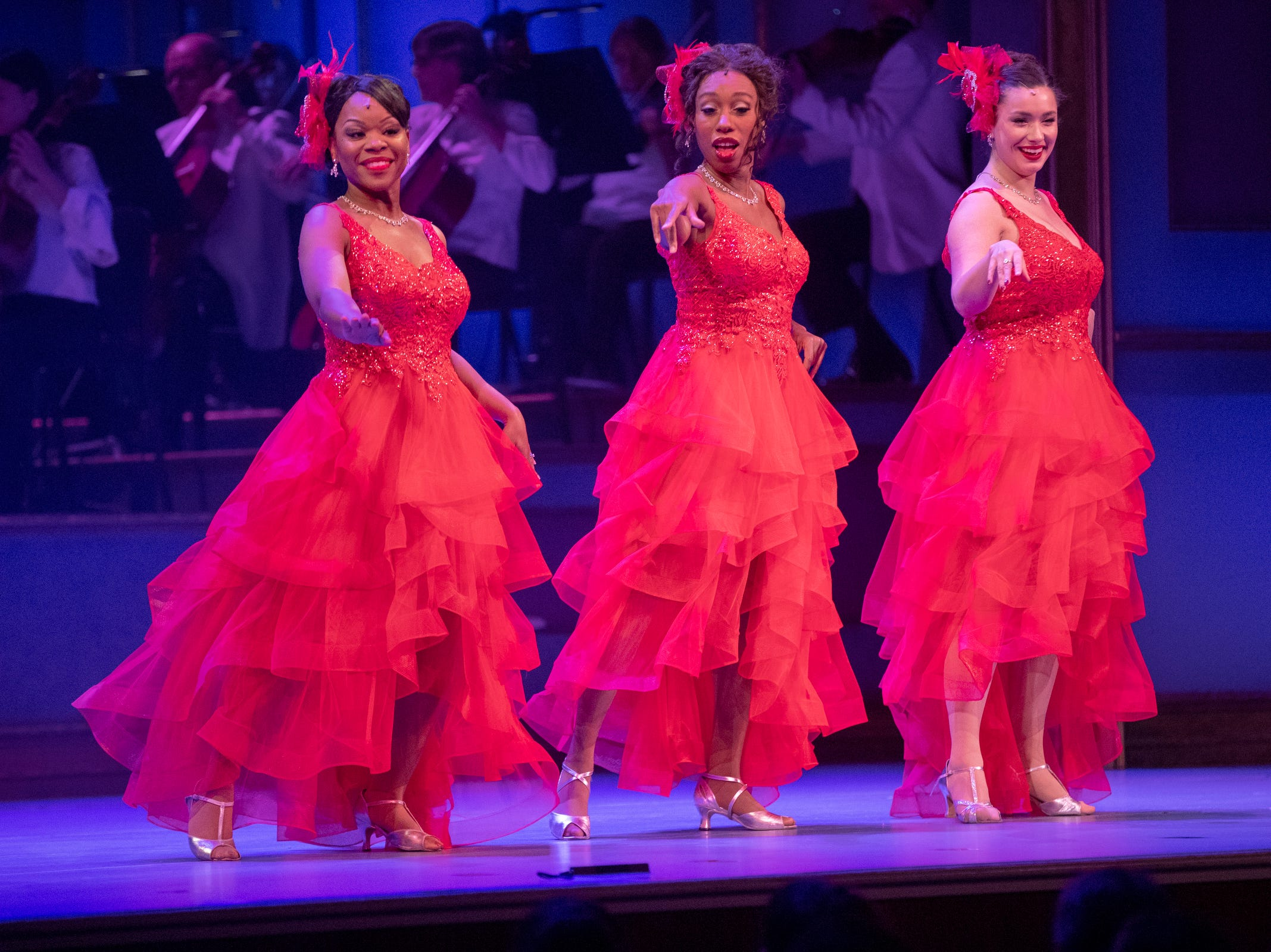 The Jingle Belles perform at Yuletide Celebration, showcasing the Indianapolis Symphony Orchestra, at Hilbert Circle Theater, Indianapolis, Sunday. Dec. 23, 2018. The extravaganza features dancing, holiday songs, and skits.