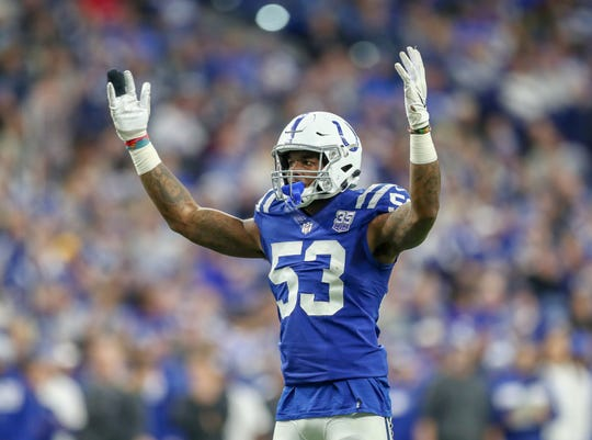 Indianapolis Colts outside linebacker Darius Leonard (53) asks for the crowd to cheer loud during a defensive stand against the New York Giants near their end zone at Lucas Oil Stadium in Indianapolis on Sunday, Dec. 23, 2018.