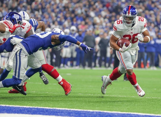 New York Giants running back Saquon Barkley (26) makes his way into the end zone against the Indianapolis Colts at Lucas Oil Stadium in Indianapolis on Sunday, Dec. 23, 2018.