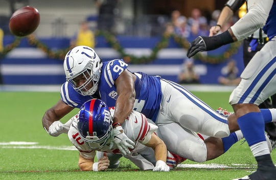 Indianapolis Colts defensive end Tyquan Lewis (94) chases down New York Giants quarterback Eli Manning (10) on a drive late in the game forcing a field goal at Lucas Oil Stadium in Indianapolis on Sunday, Dec. 23, 2018.