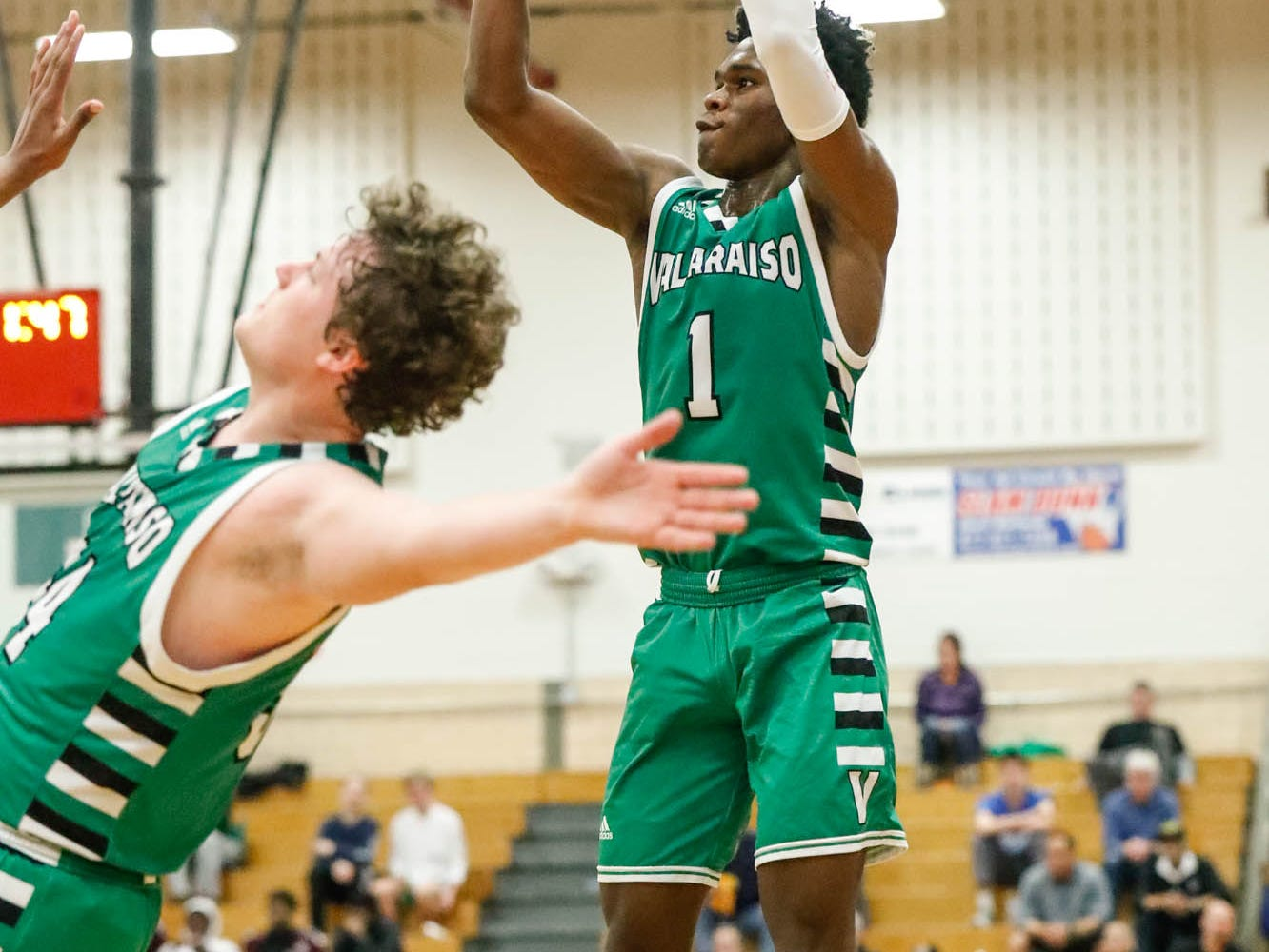 Valparaiso High School's Brandon Newman (1) shoots a three pointer during a game between Zionsville Community High School, and Valparaiso High School, in the 4th Annual Manuel Extravaganza Showcase held at Emmerich Manuel High School in Indianapolis on Saturday, Dec. 22, 2018. Left, Valparaiso High School's Jacob Evans (34).