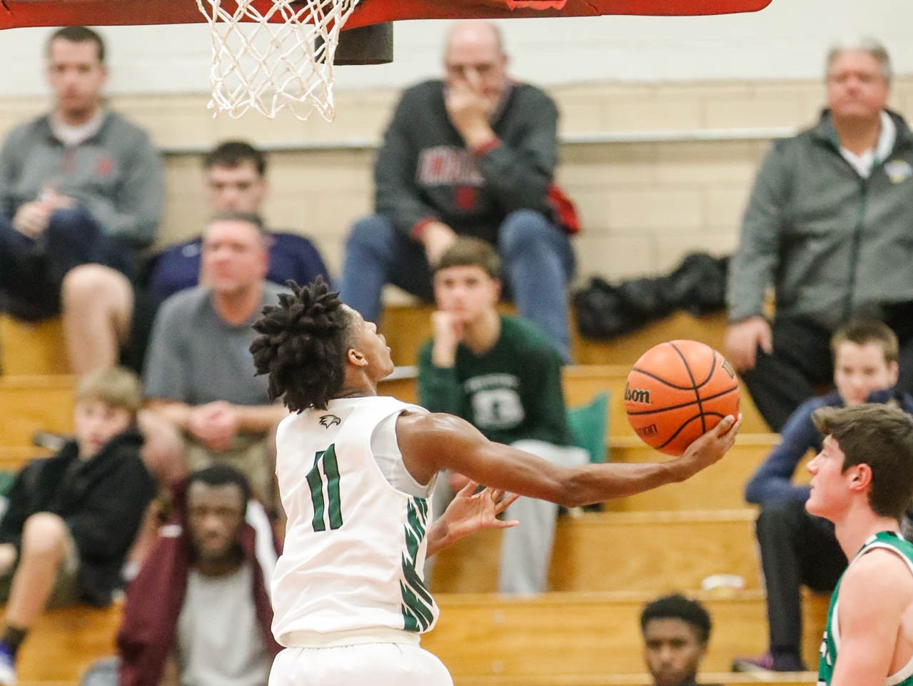 Zionsville Community High School's Isaiah Thompson (11) shoots a layup during a game between Zionsville Community High School, and Valparaiso High School, in the 4th Annual Manuel Extravaganza Showcase held at Emmerich Manuel High School in Indianapolis on Saturday, Dec. 22, 2018.