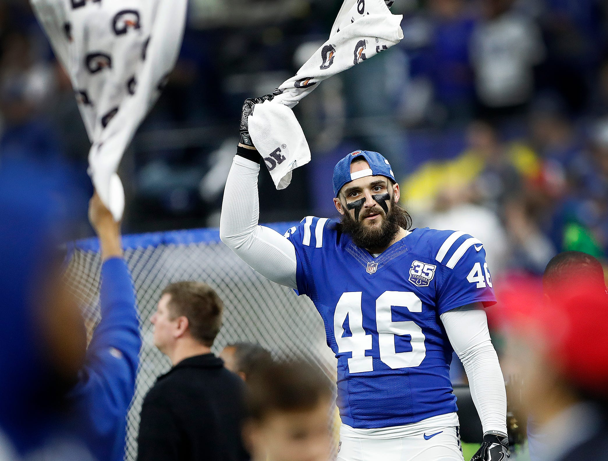 Indianapolis Colts long snapper Luke Rhodes (46) waves a towel to get the Colts fans on their feet to cheer in the second half of their game at Lucas Oil Stadium on Sunday, Dec. 23, 2018. The Colts defeated the Giants 28-27.