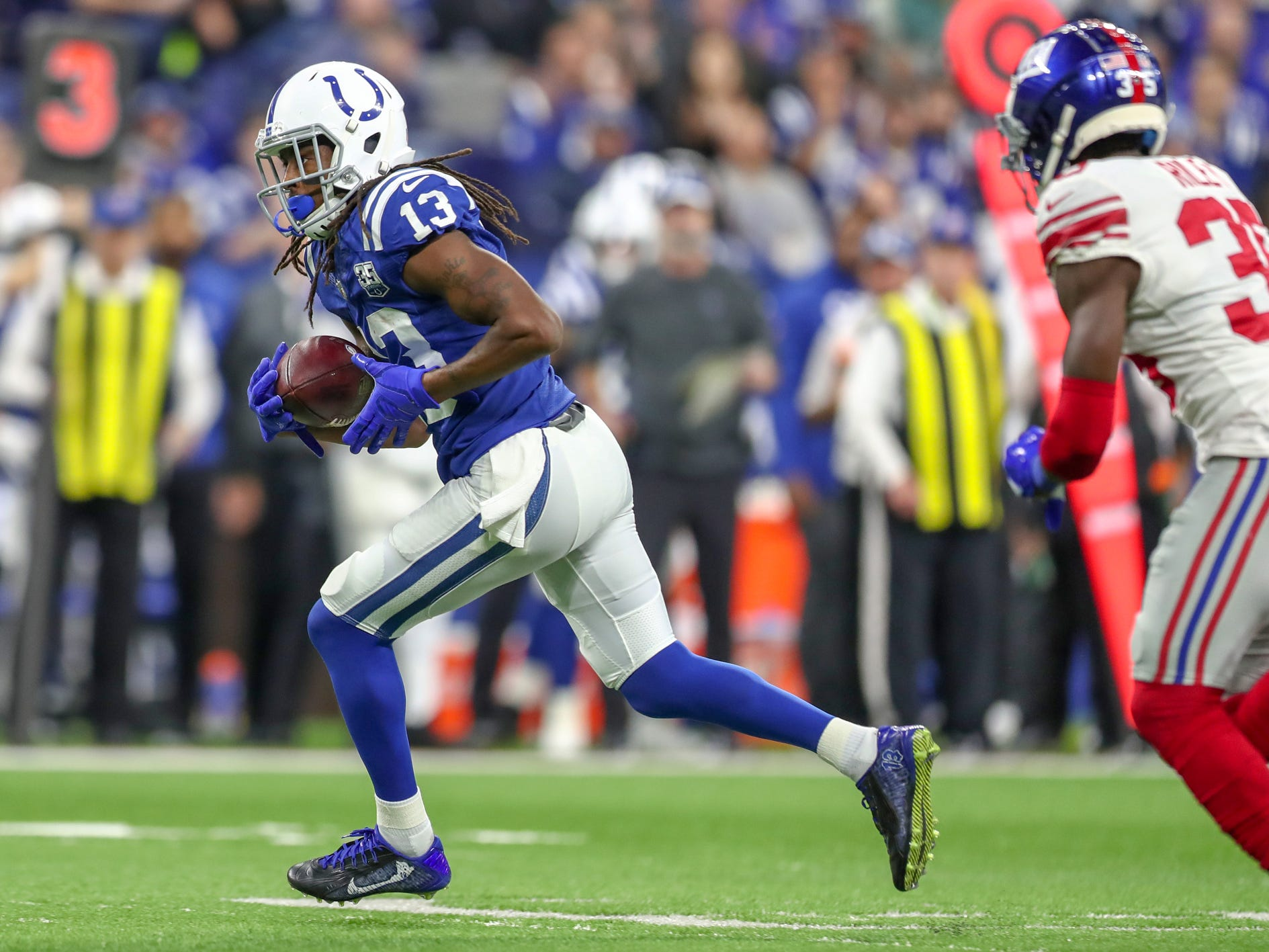 Indianapolis Colts wide receiver T.Y. Hilton (13) takes a pass downfield for the first down late in the game against the New York Giants at Lucas Oil Stadium in Indianapolis on Sunday, Dec. 23, 2018.