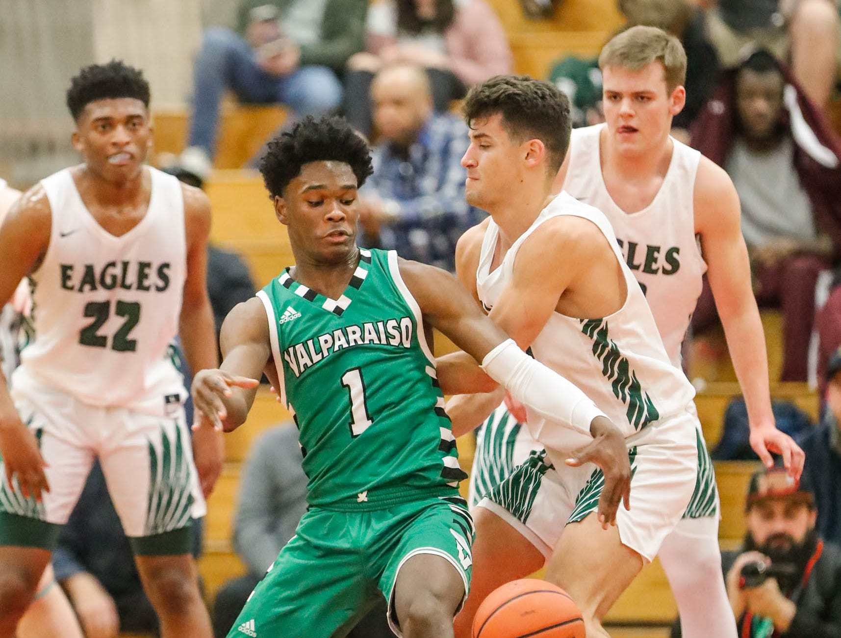 Valparaiso High School's Brandon Newman (1) chases a loose ball shoots for the hoop during a game between Zionsville Community High School, and Valparaiso High School, in the 4th Annual Manuel Extravaganza Showcase held at Emmerich Manuel High School in Indianapolis on Saturday, Dec. 22, 2018.