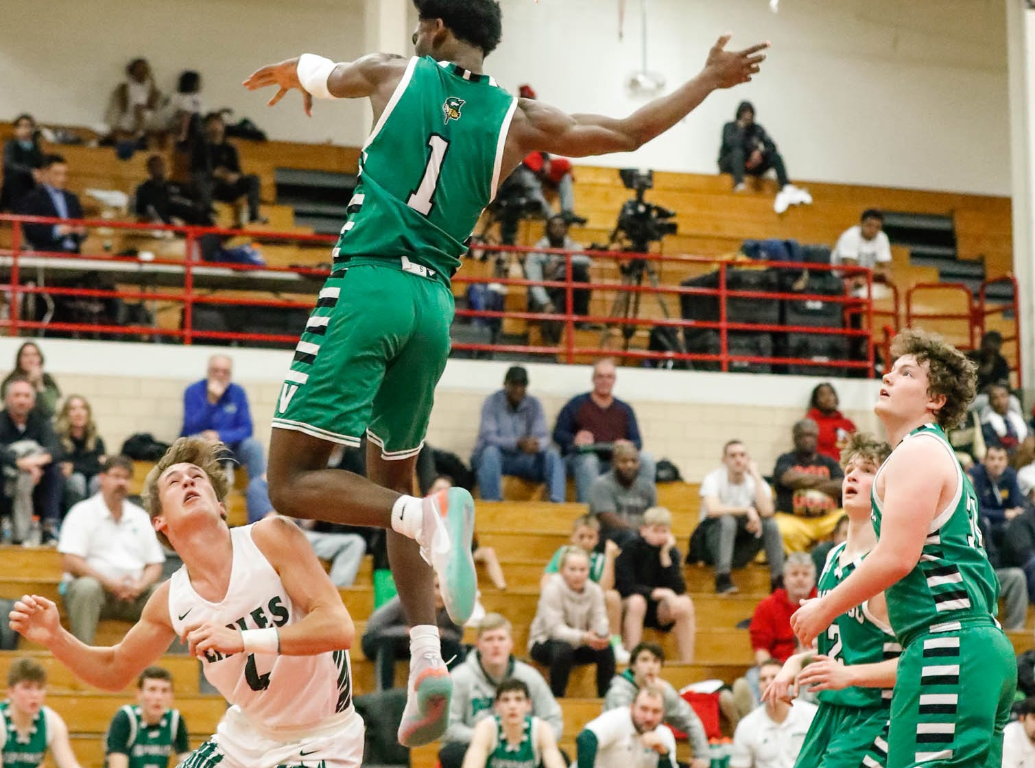 Valparaiso High School's Brandon Newman (1) leaps to block a shot and ends up in the stands during a game between Zionsville Community High School, and Valparaiso High School, in the 4th Annual Manuel Extravaganza Showcase held at Emmerich Manuel High School in Indianapolis on Saturday, Dec. 22, 2018.