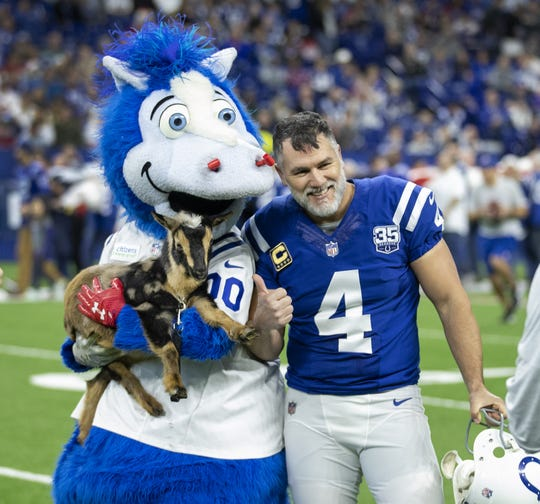 Indianapolis Colts kicker Adam Vinatieri (4) was given a GOAT from Colts mascot Blue before the start of their game at Lucas Oil Stadium on Sunday, Dec. 23, 2018.
