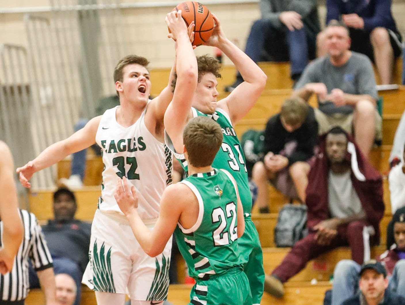 Zionsville Community High School's Hogan Orbaugh (32), Valparaiso High School's Brandon Mack (22), and Valparaiso's Jacob Evans (34), jump for a rebound during a game between Zionsville Community High School, and Valparaiso High School, in the 4th Annual Manuel Extravaganza Showcase held at Emmerich Manuel High School in Indianapolis on Saturday, Dec. 22, 2018.