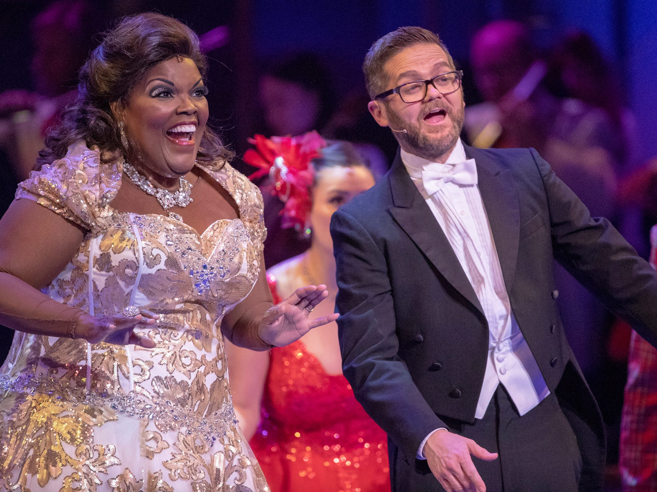 Angela Brown and Josh Kaufman sing at Yuletide Celebration, showcasing the Indianapolis Symphony Orchestra, at Hilbert Circle Theater, Indianapolis, Sunday. Dec. 23, 2018. The extravaganza features dancing, holiday songs, and skits.