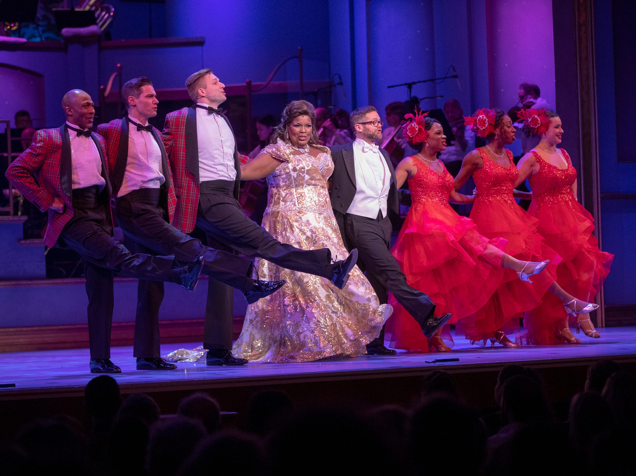 Angela Brown and Josh Kaufman lead a number at Yuletide Celebration, showcasing the Indianapolis Symphony Orchestra, at Hilbert Circle Theater, Indianapolis, Sunday. Dec. 23, 2018. The extravaganza features dancing, holiday songs, and skits.